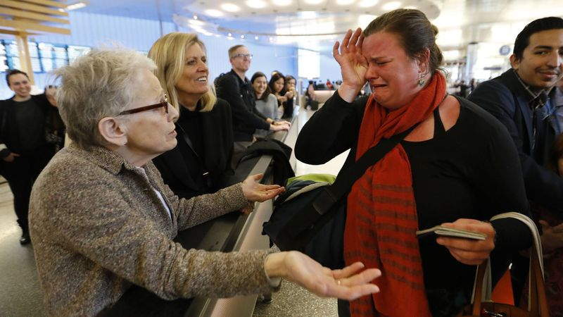 Nora Phillips, right, is in tears as she is greeted by fellow immigration attorney Helen Sklar, left, as Phillips arrived at Los Angeles International Airport. (Credit: Al Seib / Los Angeles Times)