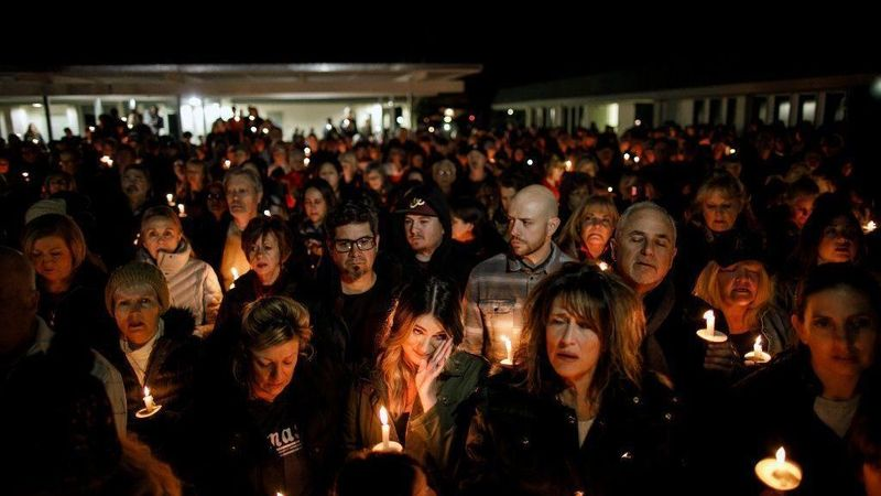 Community members attend a vigil at the Glenknoll Elementary School in Yorba Linda on Feb. 7, 2019, to remember the four people killed when plane debris crashed into their home. (Credit: Marcus Yam / Los Angeles Times)