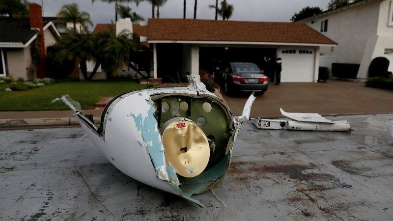 Pieces of a Cessna airplane that broke apart in midair lie in a Yorba Linda neighborhood on Feb. 3, 2019. (Credit: Allen J. Schaben / Los Angeles Times)