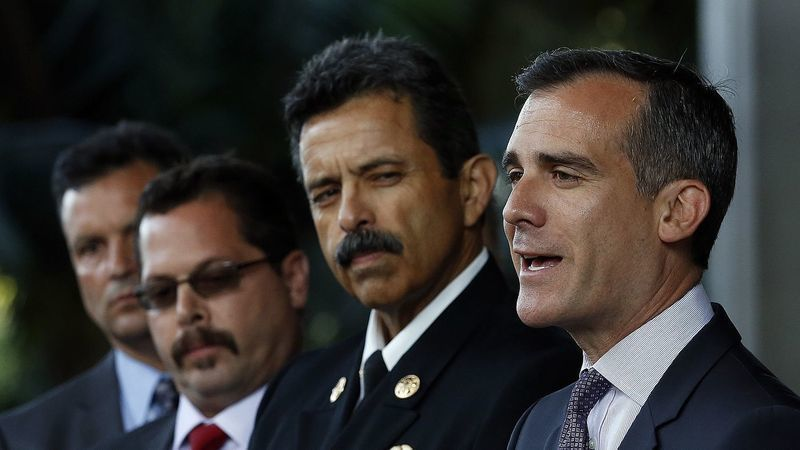 Los Angeles Mayor Eric Garcetti stands next to city Fire Chief Ralph Terraza in an undated photo. (Credit: Mel Melcon / Los Angeles Times)