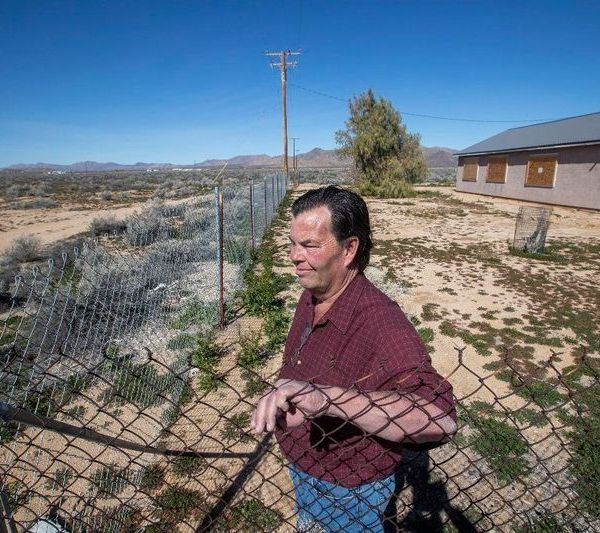 Brian Hammer at his 14-acre property in Lucerne Valley, where he and his wife hope to retire, on Feb. 25, 2019. (Credit: Allen J. Schaben / Los Angeles Times)