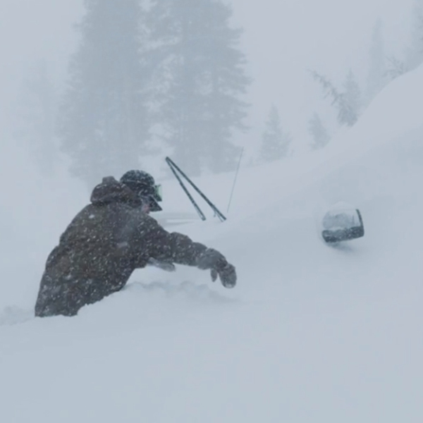 A person tries to walk through waist-high snow in Mammoth earlier this month. (Credit: MMSA)