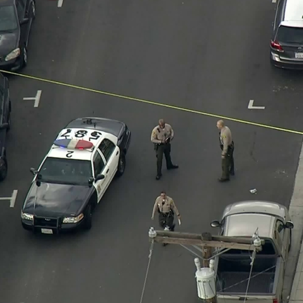 Officers work at the scene of a shooting in Maywood on Feb. 18, 2019. (Credit: KTLA)