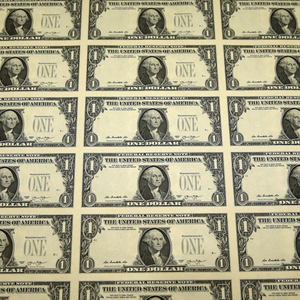 Dollar bills are seen in a file photo. (Credit: Mark Wilson/Getty Images)