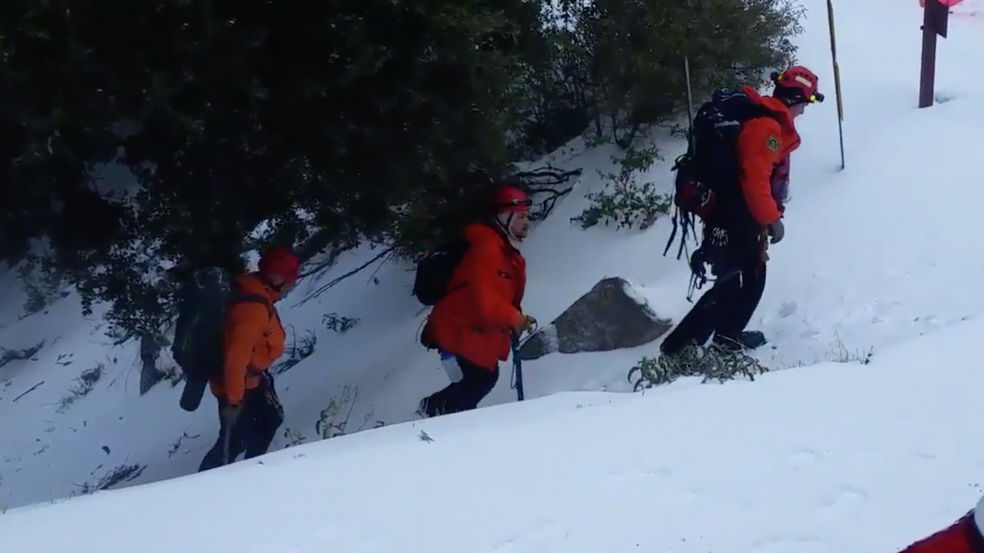 Los Angeles County Sheriff's Department Search & Rescue Team Members work at the scene where a runner slipped on ice and fell to his death along a trail near Mt. Wilson on Feb. 17, 2019. (Credit: Los Angeles County Sheriff's Department)