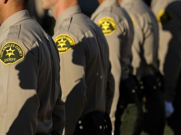Los Angeles County sheriff's deputies stand at attention during a graduation ceremony in East Los Angeles on Oct. 27, 2017.(Mel Melcon / Los Angeles Times)