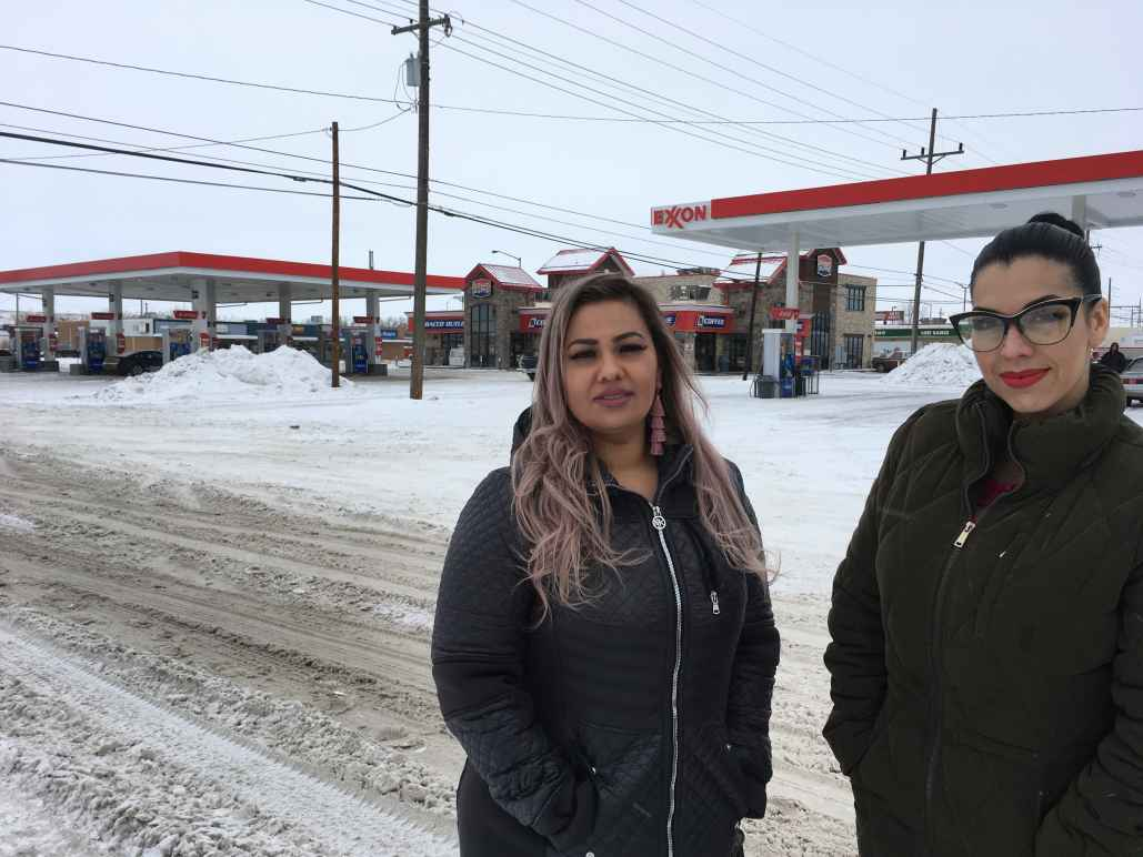 Martha Hernandez, left, and Ana Suda pose in front of a convenience store in Havre, Montana, where they say they were detained by a Border Patrol agent for speaking Spanish in this Jan. 23, 2019, photo provided by the ACLU of Montana.