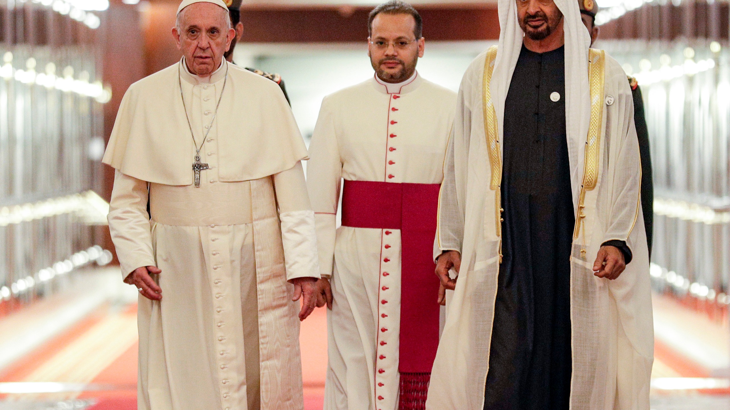 Pope Francis (C-L) is welcomed by Abu Dhabi's Crown Prince Sheikh Mohammed bin Zayed al-Nahyan (C-R) upon his arrival at Abu Dhabi International Airport in the UAE capital on February 3, 2019. (Credit: Andrew Medichini / POOL / AFP/Getty Images)