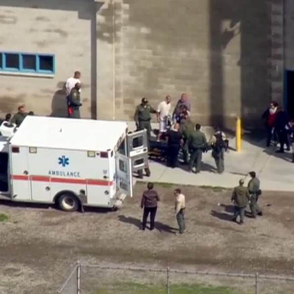 A person could be seen being taken away by an ambulance at Donovan State Prison in Otay Mesa on Feb. 15, 2019. (Credit: KSWB)