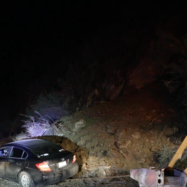 Crews pull out a car from the scene of a rock slide in the Castaic area on Feb. 5, 2019. (Credit: Loudlabs)