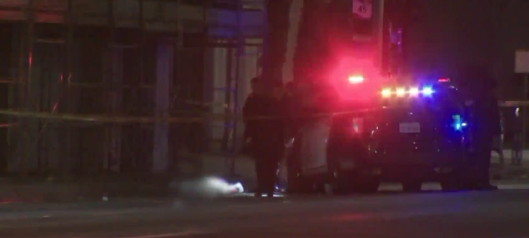 Police are seen investigating the scene after a man was fatally shot in Long Beach on Jan. 23, 2019. (Credit: KTLA)