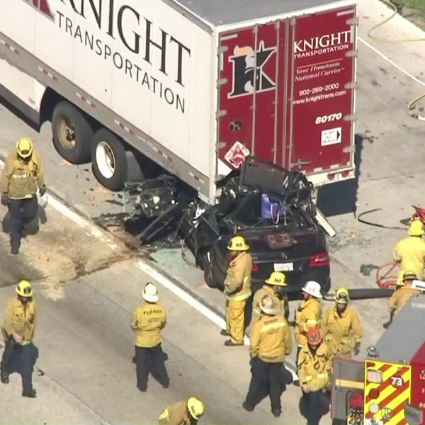 A vehicle ended up stuck under a semi truck after a crash along the 5 Freeway near Sylmar on Feb. 19, 2019. (Credit: KTLA)