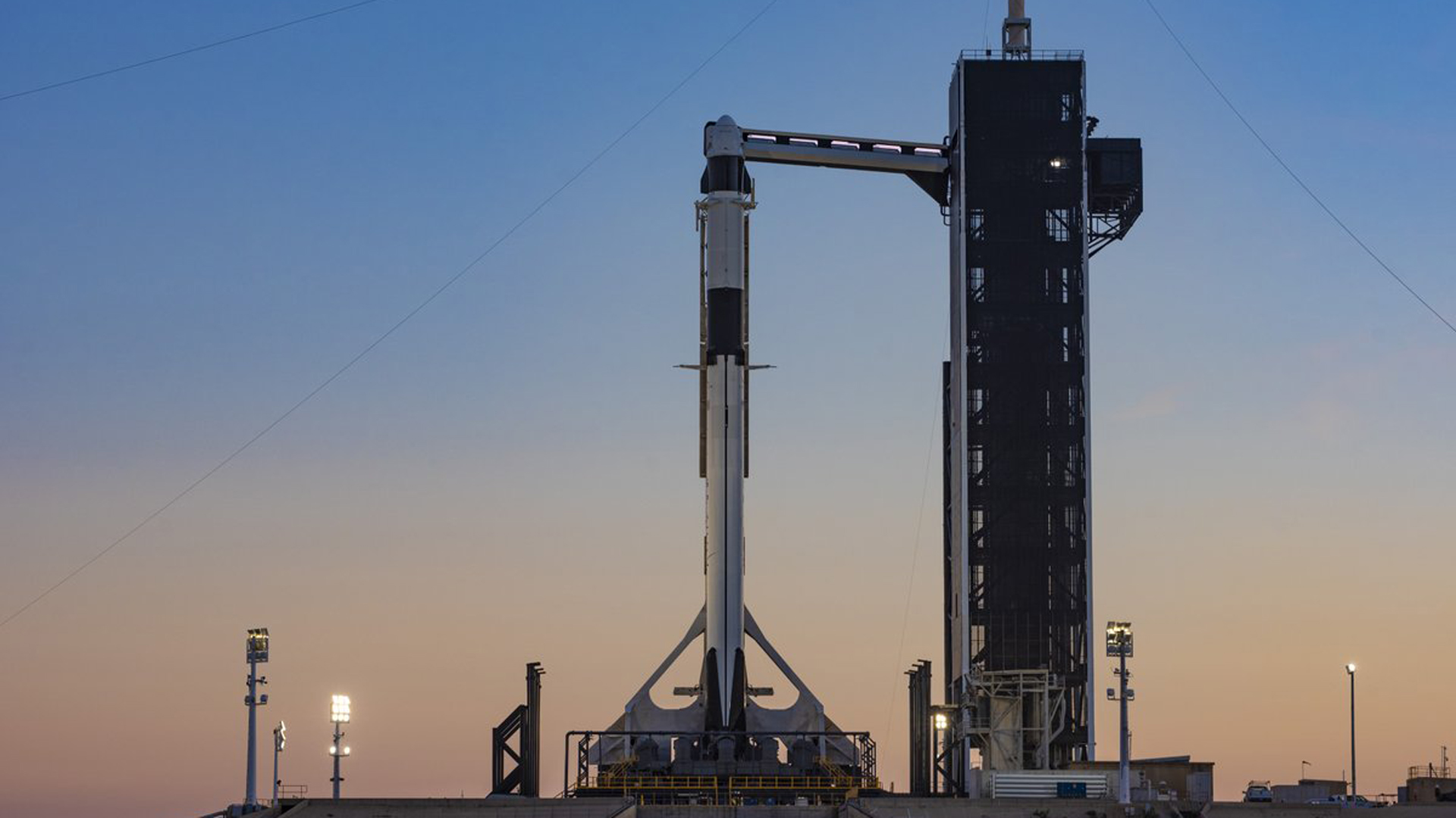 SpaceX's Crew Dragon capsule sits perched atop a Falcon 9 rocket at Kennedy Space Center in Florida on Feb. 28, 2019, ahead of it's planned maiden voyage on March 2, 2019. (Credit: SpaceX)