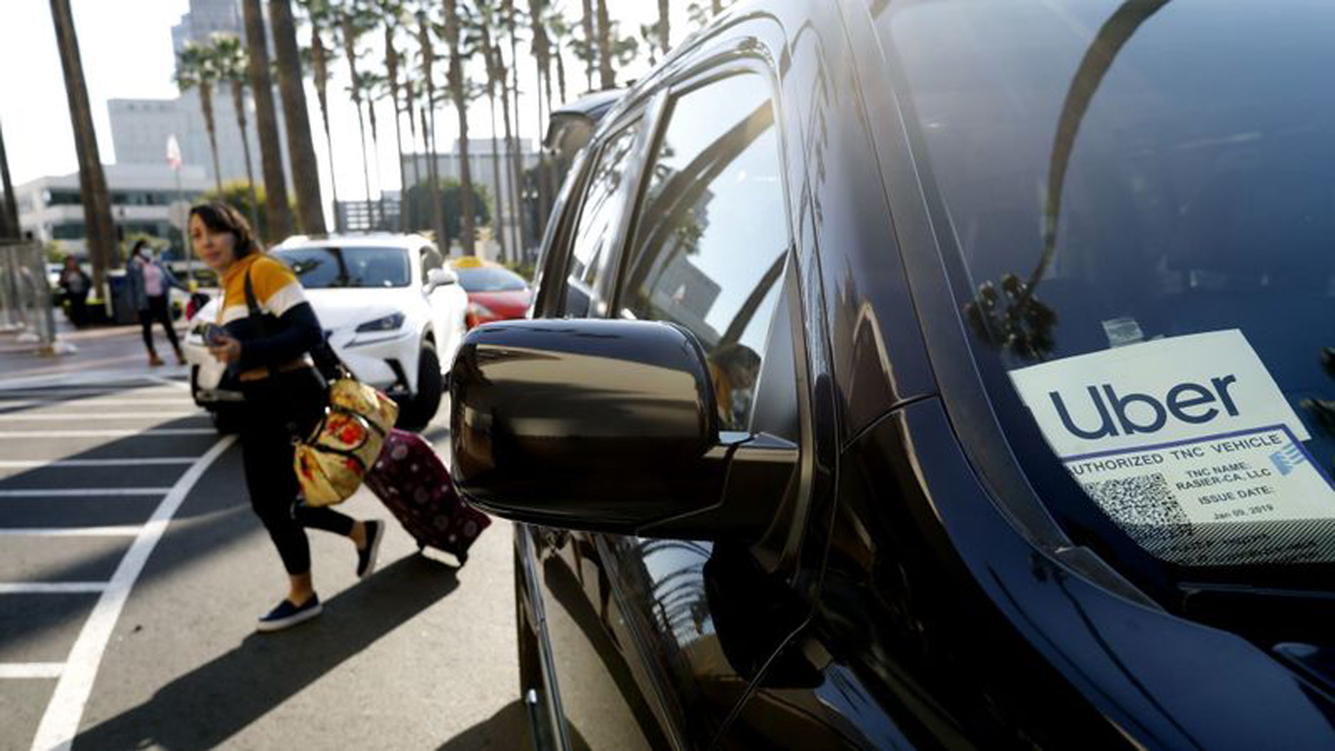 A passenger exits an Uber at Union Station in Los Angeles in this undated photo. (Credit: Francine Orr / Los Angeles Times)