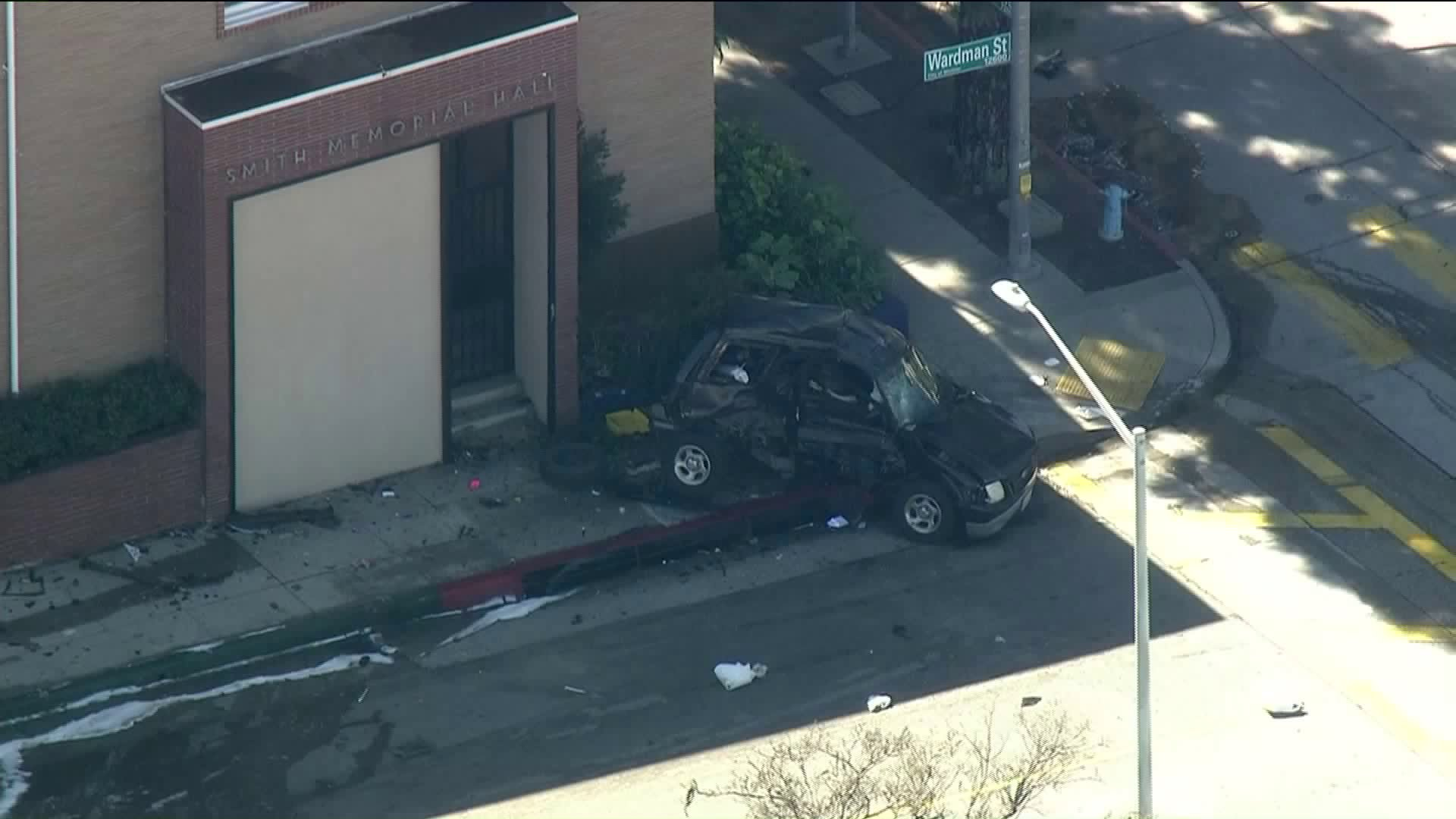 A police pursuit ended with a fiery crash in Whittier on Feb. 18, 2019, sending both a suspect and an uninvolved motorist to the hospital, officials said. (Credit: KTLA)