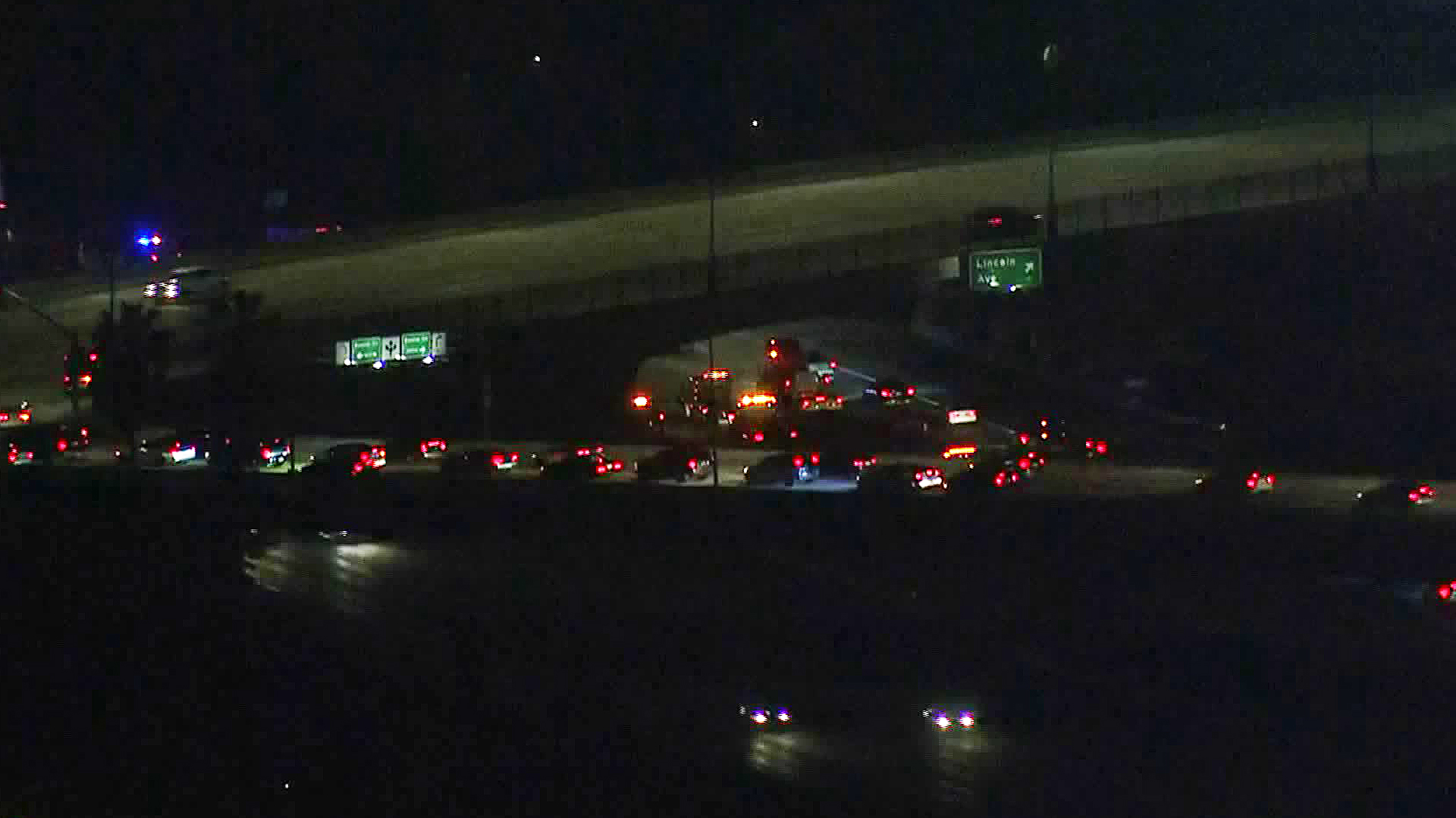 Officials investigate a fatal crash on the 5 Freeway in Anaheim on March 13, 2019. (Credit: KTLA)