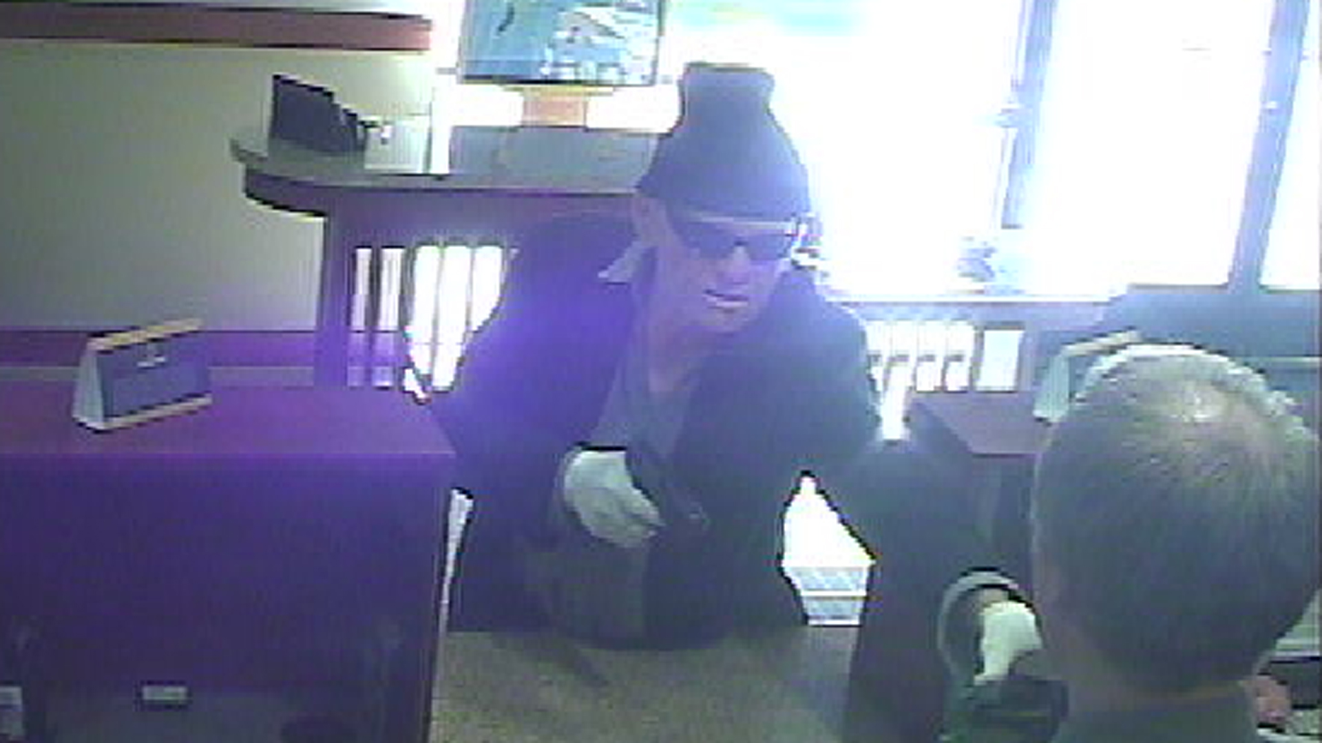 Newport Beach police are seeking the man pictured in this surveillance photo in connection with a bank robbery at OneWest Bank, 3700 East Coast Highway in Corona Del Mar, on March 7, 2019. (Credit: Newport Beach Police Department)