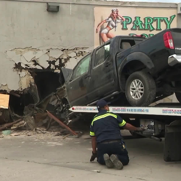 A truck is pulled out of the Party Dolls bar in Highland on March 20, 2019. (Credit: KTLA)