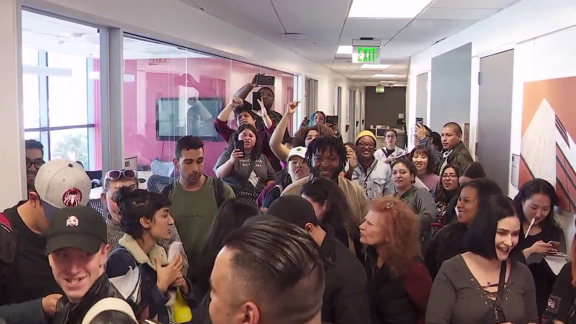 Students crowd a hallway at the Art Institute of California in Hollywood on March 7, 2019. (Credit: KTLA)