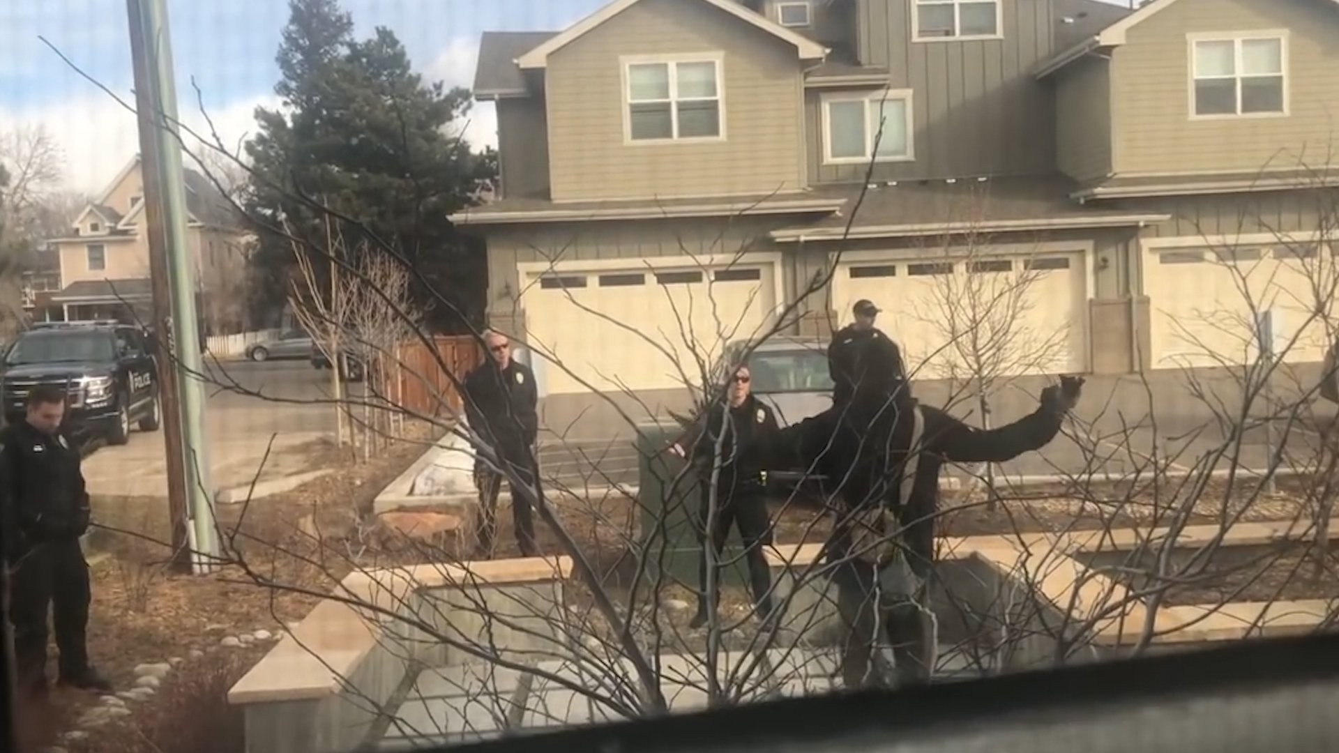 A still from a bystander's video shows Boulder police officers and the man they confronted. (CNN)