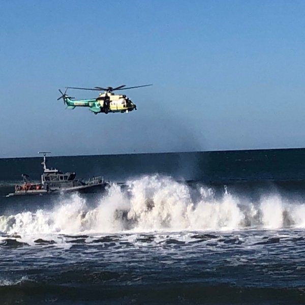 A helicopter crew searches for a missing swimmer near the Santa Monica Pier on March 13, 2019. (Credit: L.A. County Sheriff's Department's Special Enforcement Bureau/Twitter)
