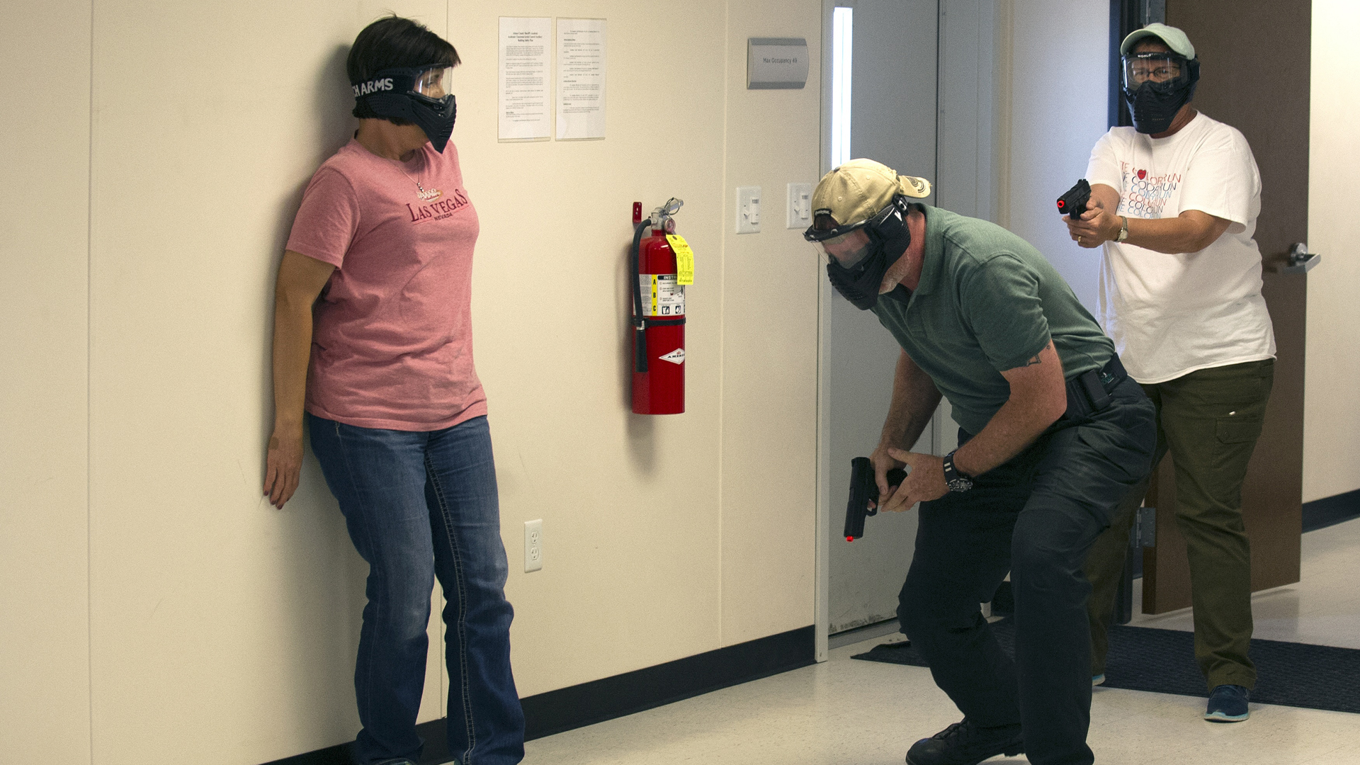 School teachers and administrators participate in an Airsoft mock active shooter drill in Colorado during a three day firearms course in Commerce City, Colorado on June 28, 2018. (Credit: JASON CONNOLLY/AFP/Getty Images)