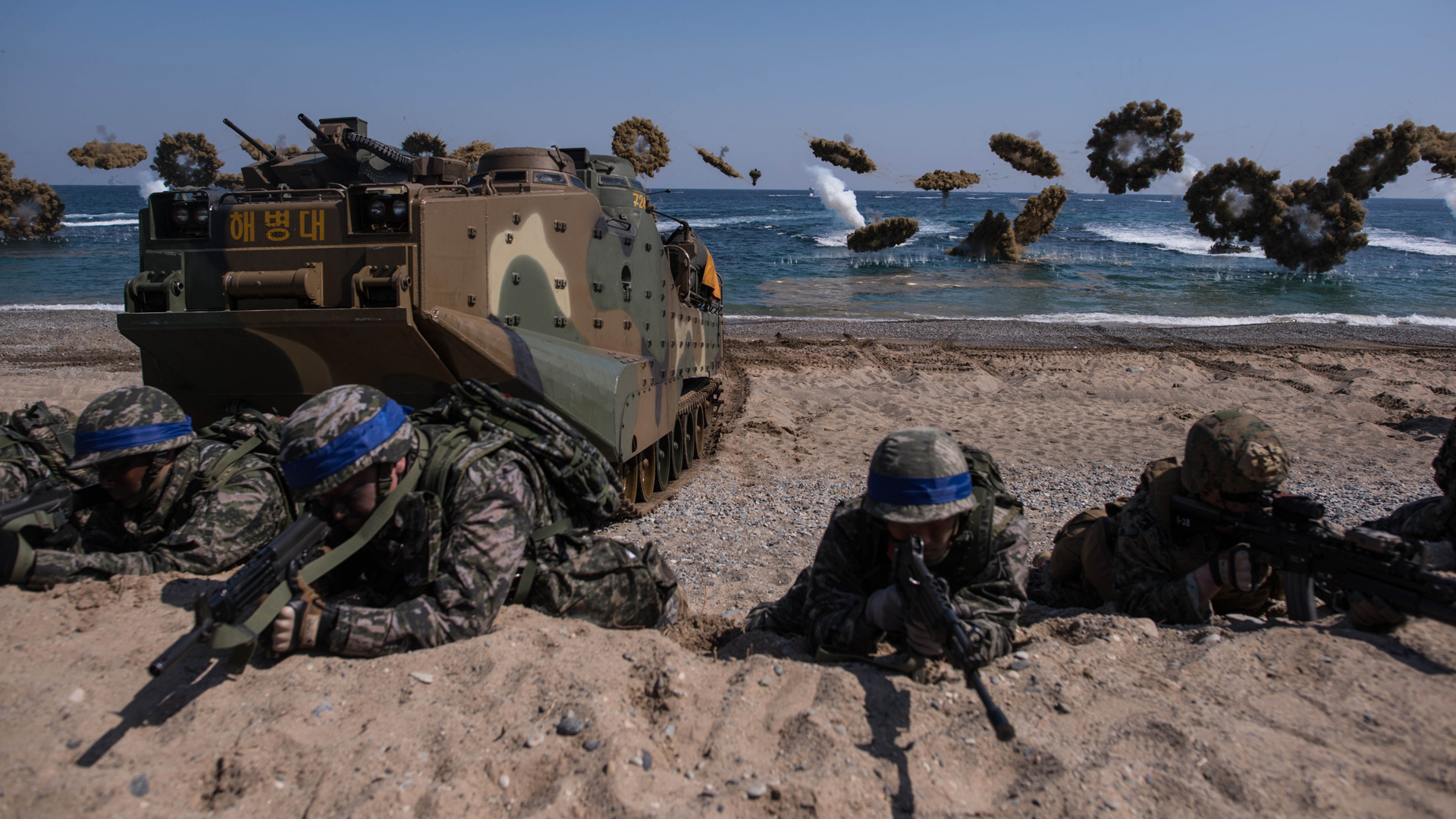 U.S. and South Korean soldiers take a position during an annual joint military landing exercise in Pohang, on South Korea's southeast coast, on March 12, 2016. (Credit: ED JONES/AFP/Getty Images)