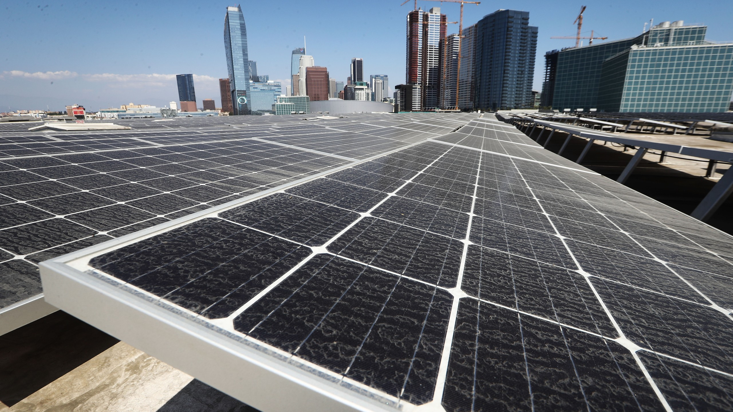 Solar panels are mounted atop the roof of the Los Angeles Convention Center on Sept. 5, 2018. (Credit: Mario Tama / Getty Images)