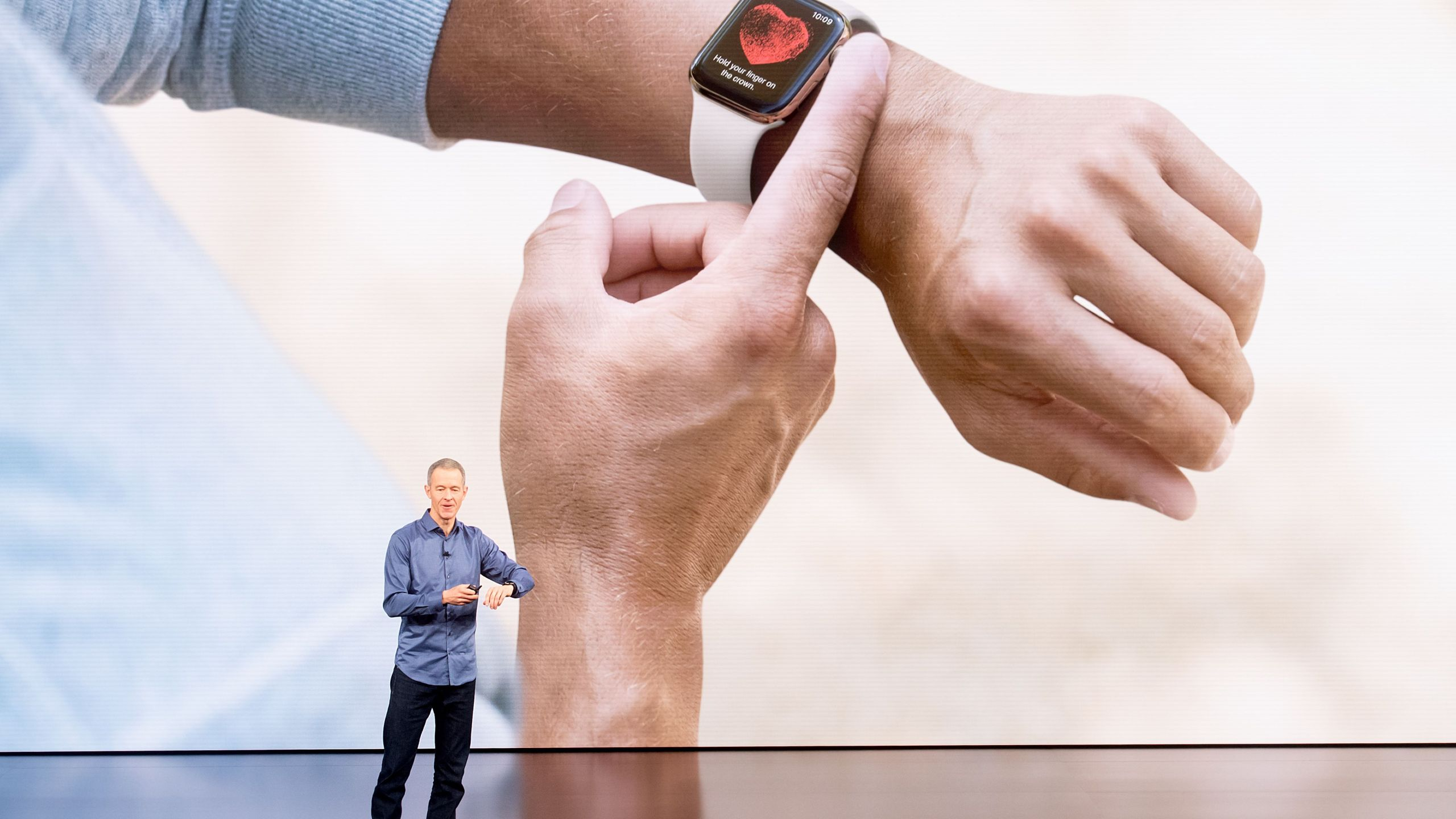 Apple COO Jeff Williams discusses Apple Watch Series 4 during an event on Sept. 12, 2018 in Cupertino. (Credit: NOAH BERGER/AFP/Getty Images)