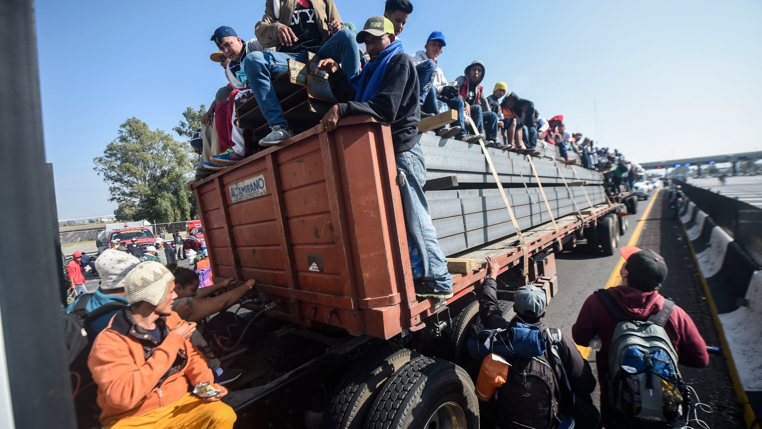 Central American migrants taking part in a caravan to the U.S. are pictured on board a truck heading to Irapuato in the central Mexican state of Guanajuato on Nov. 11, 2018. (Credit: Alfredo Estrella / AFP / Getty Images)