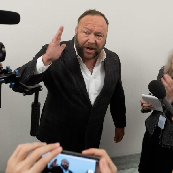 Conservative commentator Alex Jones speaks outside the hearing room prior to testimony by Google CEO Sundar Pichai during a House Judiciary Committee hearing on Capitol Hill, Dec. 11, 2018. (Credit: Saul Loeb / AFP / Getty Images)