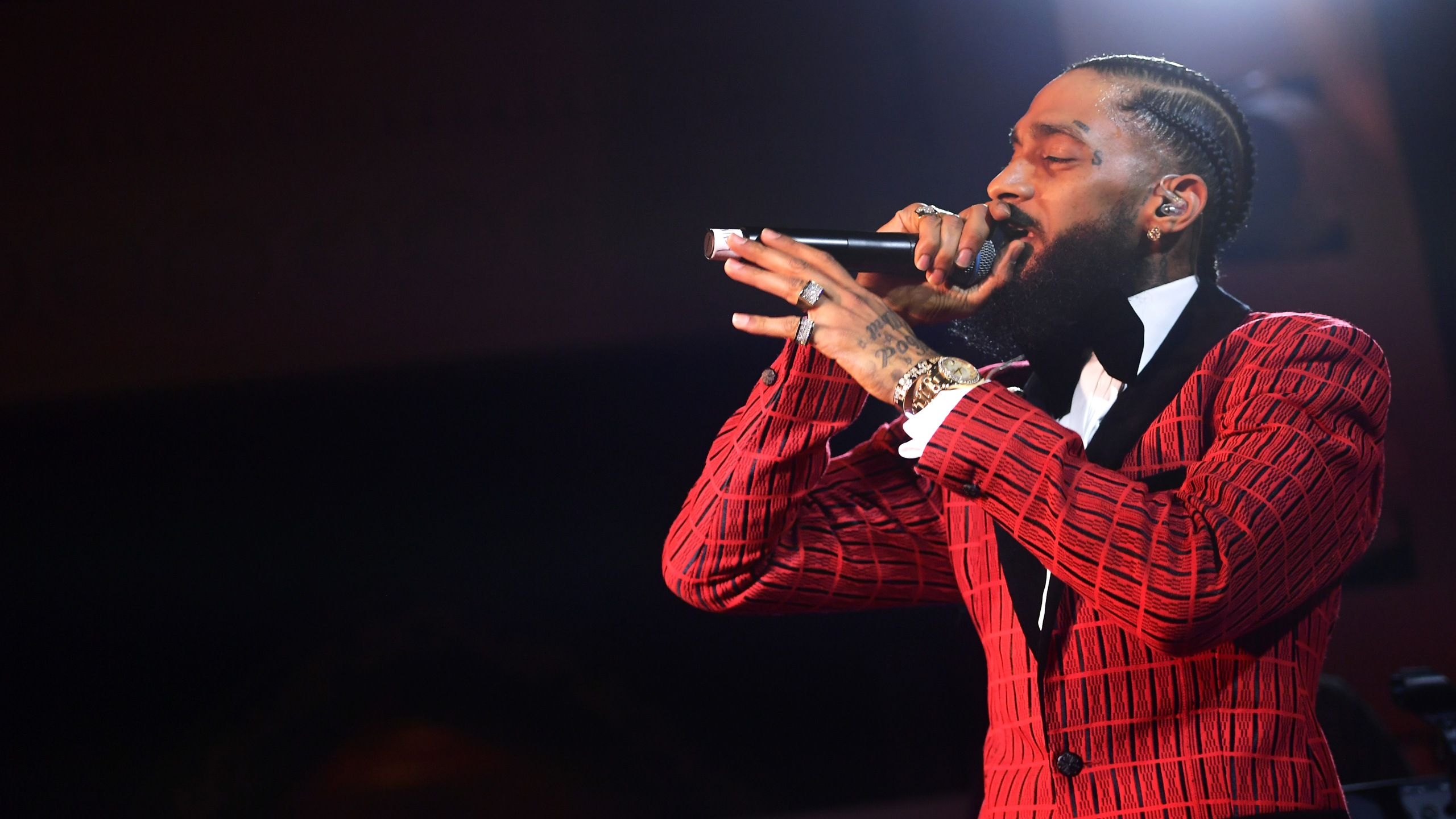 Nipsey Hussle performs onstage at the Warner Music Pre-Grammy Party at the NoMad Hotel on Feb. 7, 2019, in Los Angeles. (Credit: Matt Winkelmeyer/Getty Images for Warner Music)
