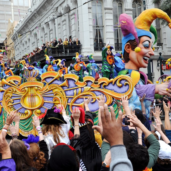 Large crowds reach up for beads as the Jester float in the traditional Rex parade rolls down Canal Street on Mardi Gras March 8, 2011 in News Orleans, Louisiana. (Credit: Cheryl Gerber/Getty Images)