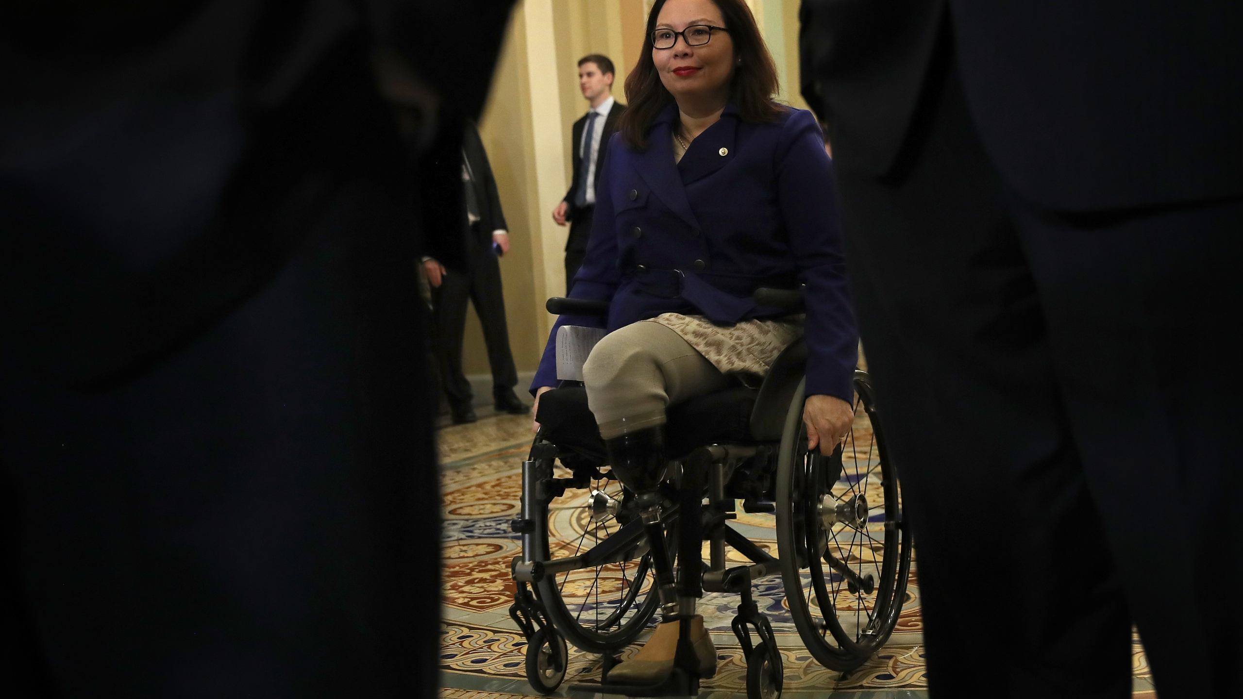 Sen. Tammy Duckworth arrives for a press conference with Democratic leaders following the Democratic policy luncheon in Washington, DC, on Jan. 29, 2019. (Credit: Win McNamee / Getty Images)