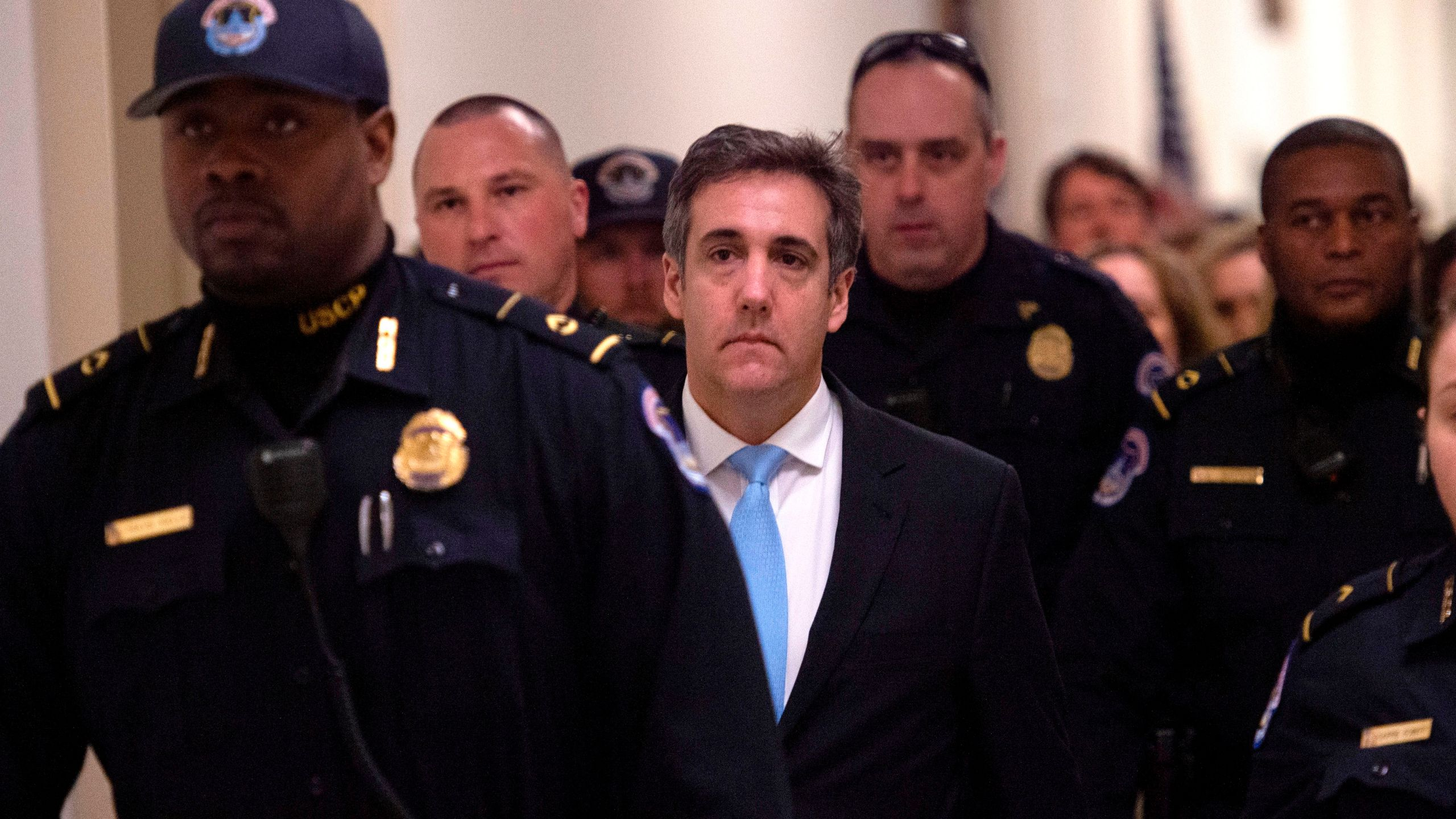 Michael Cohen leaves after testifying before the House Oversight and Reform Committee in the Rayburn House Office Building on Capitol Hill in Washington, DC on February 27, 2019. (Credit: ANDREW CABALLERO-REYNOLDS/AFP/Getty Images)