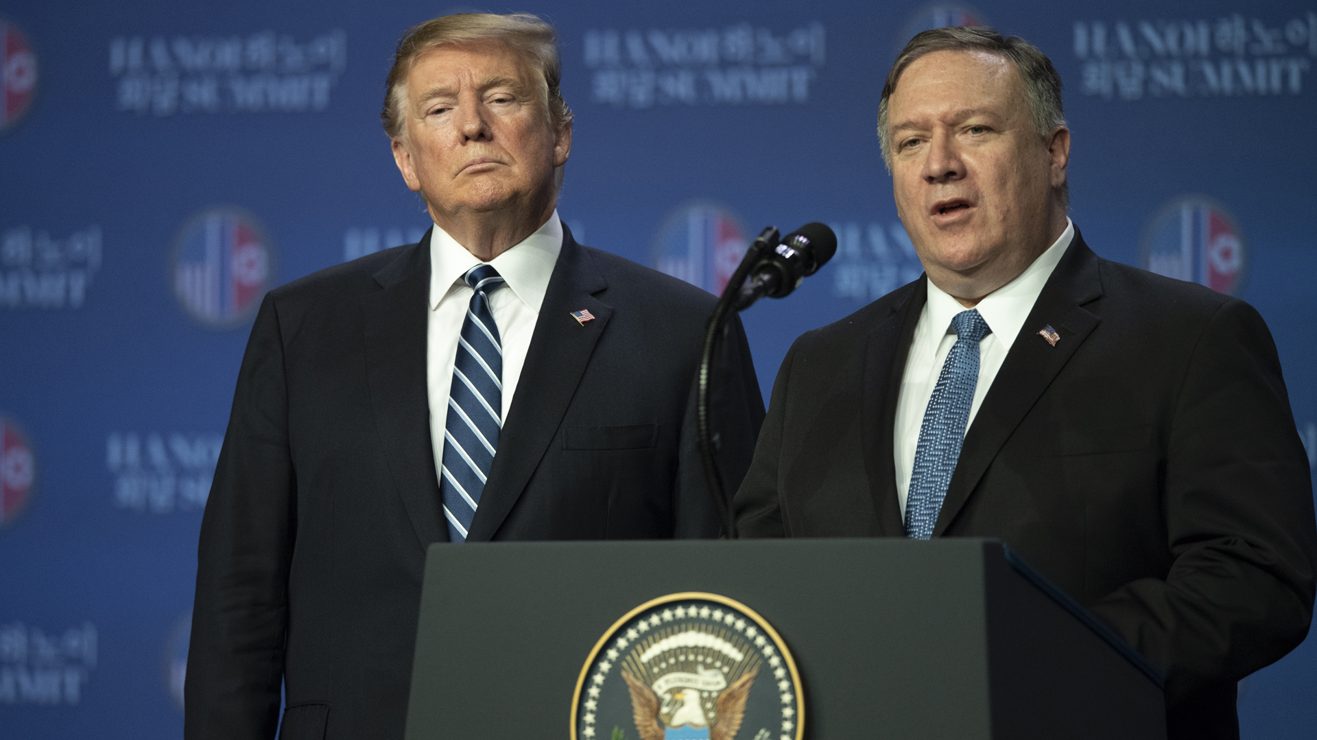 Secretary of State Mike Pompeo speaks at a news conference while President Donald Trump looks on following his second summit meeting with North Korean leader Kim Jong-un on Feb. 28, 2019 in Hanoi, Vietnam. (Credit: Tuan Mark/Getty Images)
