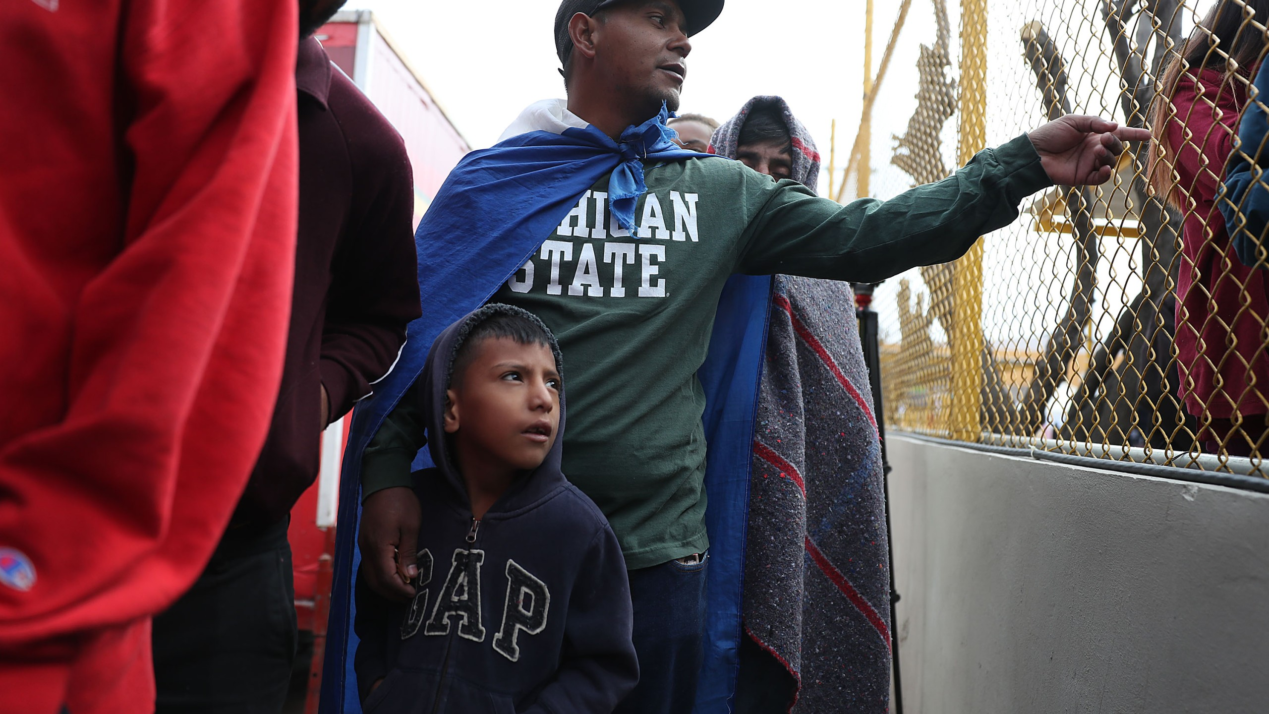 Jose Martinez and his son, Jonathan Martinez, both of whom are from Honduras, join other migrants, most of whom are part of a recently arrived caravan, at a migrant hostel in Piedras Negras, Mexico, as they wait to apply for asylum in to the United States on Feb. 9, 2019. (Credit: Joe Raedle / Getty Images)