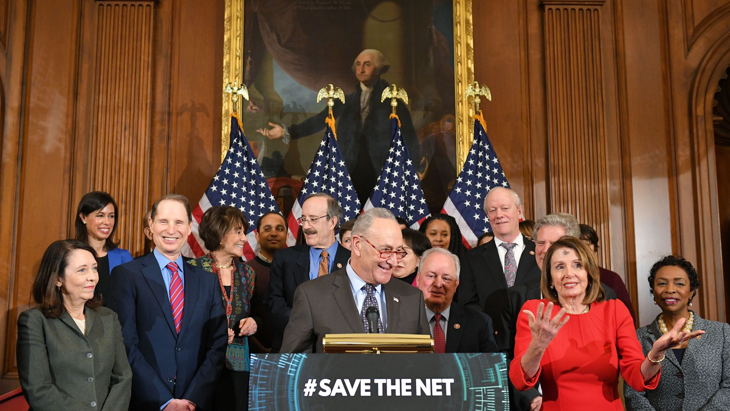 House Majority Leader Chuck Schumer, at podium, speaks with House Speaker Nancy Pelosi to his left during an event to announce net neutrality legislation in the Rayburn Room of the U.S. Capitol on March 6, 2019. (Credit: Mandel Ngan / AFP / Getty Images)