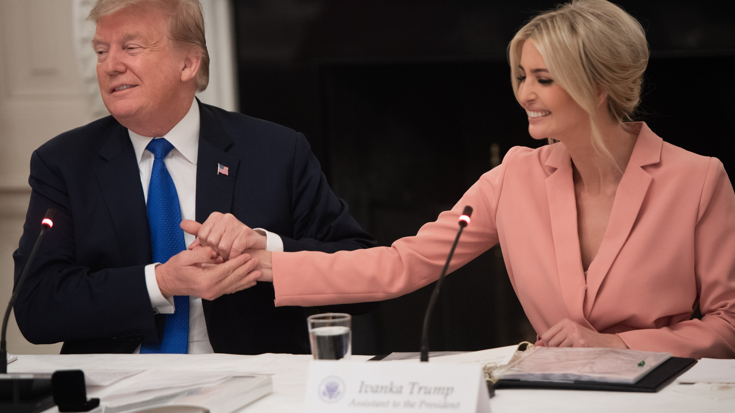 US President Donald Trump speaks alongside senior advisor and daughter Ivanka Trump (R) during the first meeting of the American Workforce Policy Advisory Board in the State Dining Room of the White House in Washington, DC, March 6, 2019. (Credit: SAUL LOEB/AFP/Getty Images)