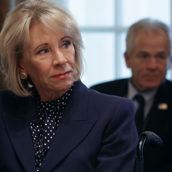 Education Secretary Betsy DeVos listens to U.S. President Donald Trump talk to reporters during a cabinet meeting in the Cabinet Room at the White House Feb. 12, 2019, in Washington, D.C. (Credit: Chip Somodevilla/Getty Images)