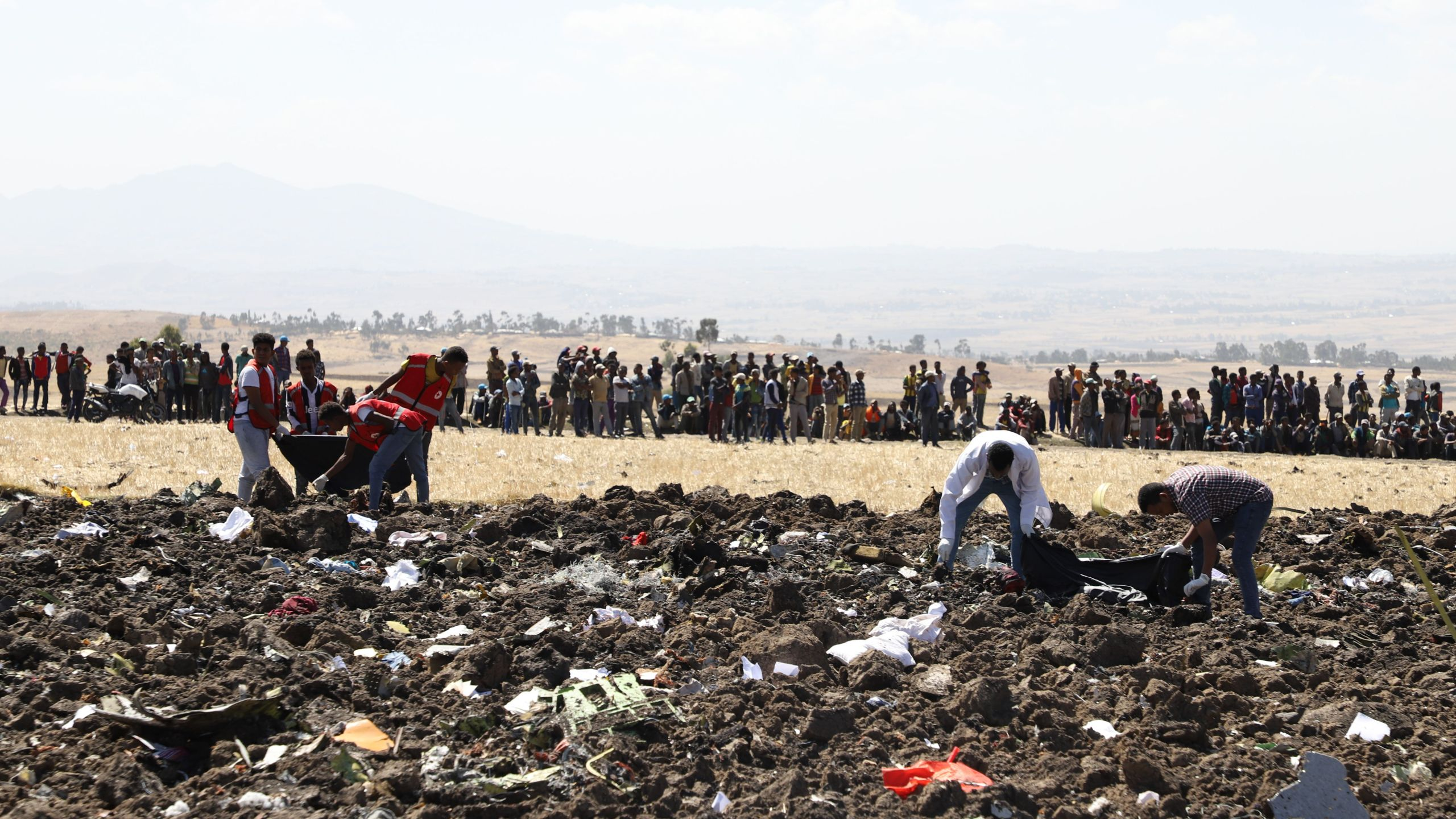 Rescue team collect remains of bodies amid debris at the crash site of Ethiopia Airlines near Bishoftu, Ethiopia, on March 10, 2019. -(Credit: MICHAEL TEWELDE/AFP/Getty Images)