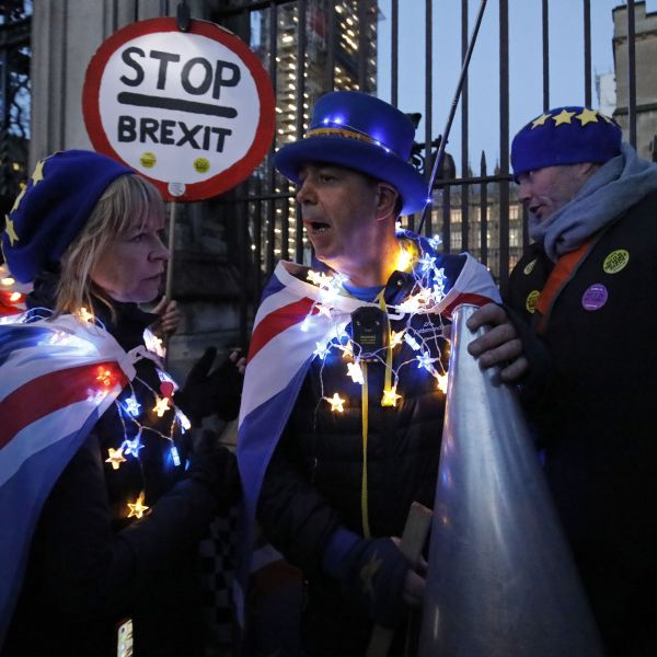 Anti-Brexit activist Steve Bray, center, and supporters protest outside the Houses of Parliament in London on March 12, 2019. (Credit: TOLGA AKMEN/AFP/Getty Images)