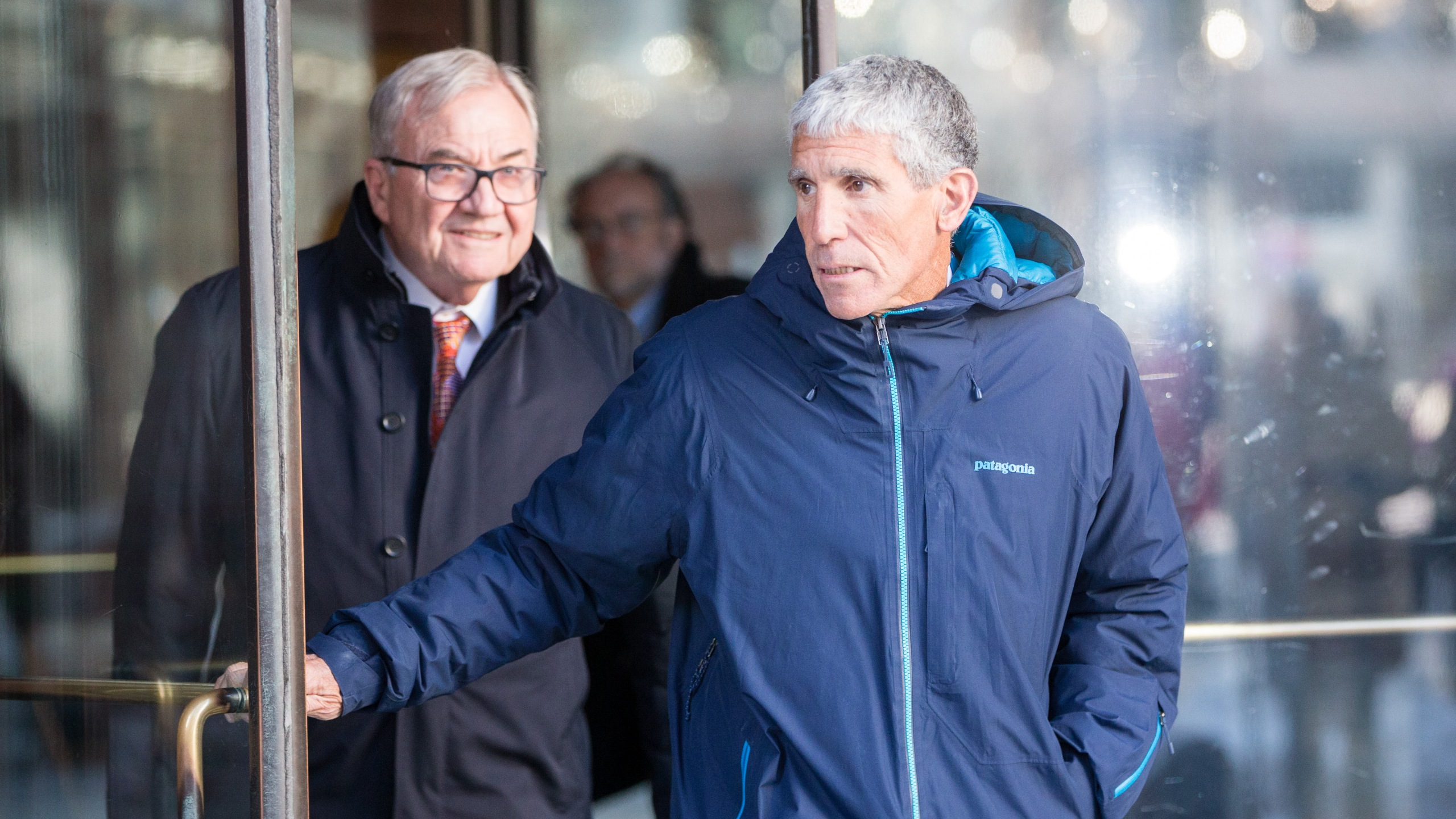 """William """"Rick"""" Singer leaves Boston Federal Court after being charged with racketeering conspiracy, money laundering conspiracy, conspiracy to defraud the United States, and obstruction of justice on March 12, 2019 in Boston, Mass. (Credit: Scott Eisen/Getty Images)"""