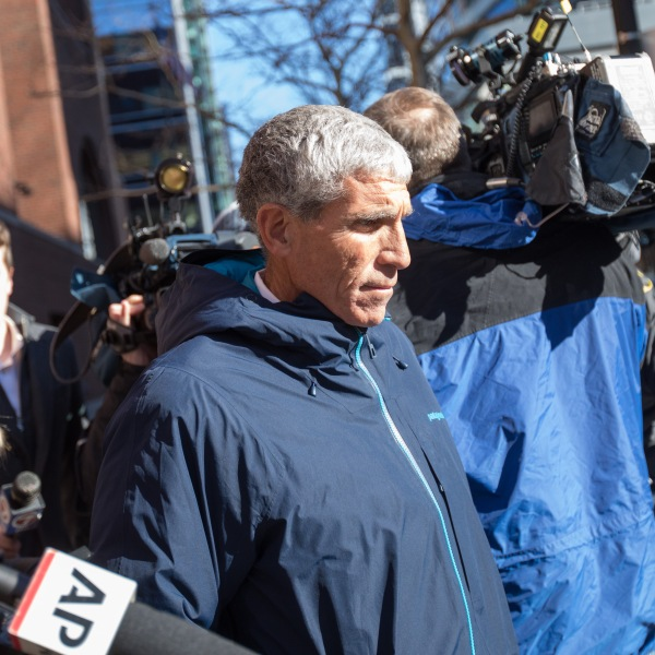 "William ""Rick"" Singer leaves Boston Federal Court after being charged with racketeering conspiracy, money laundering conspiracy, conspiracy to defraud the United States, and obstruction of justice on March 12, 2019, in Boston, Mass. (Credit: Scott Eisen/Getty Images)"