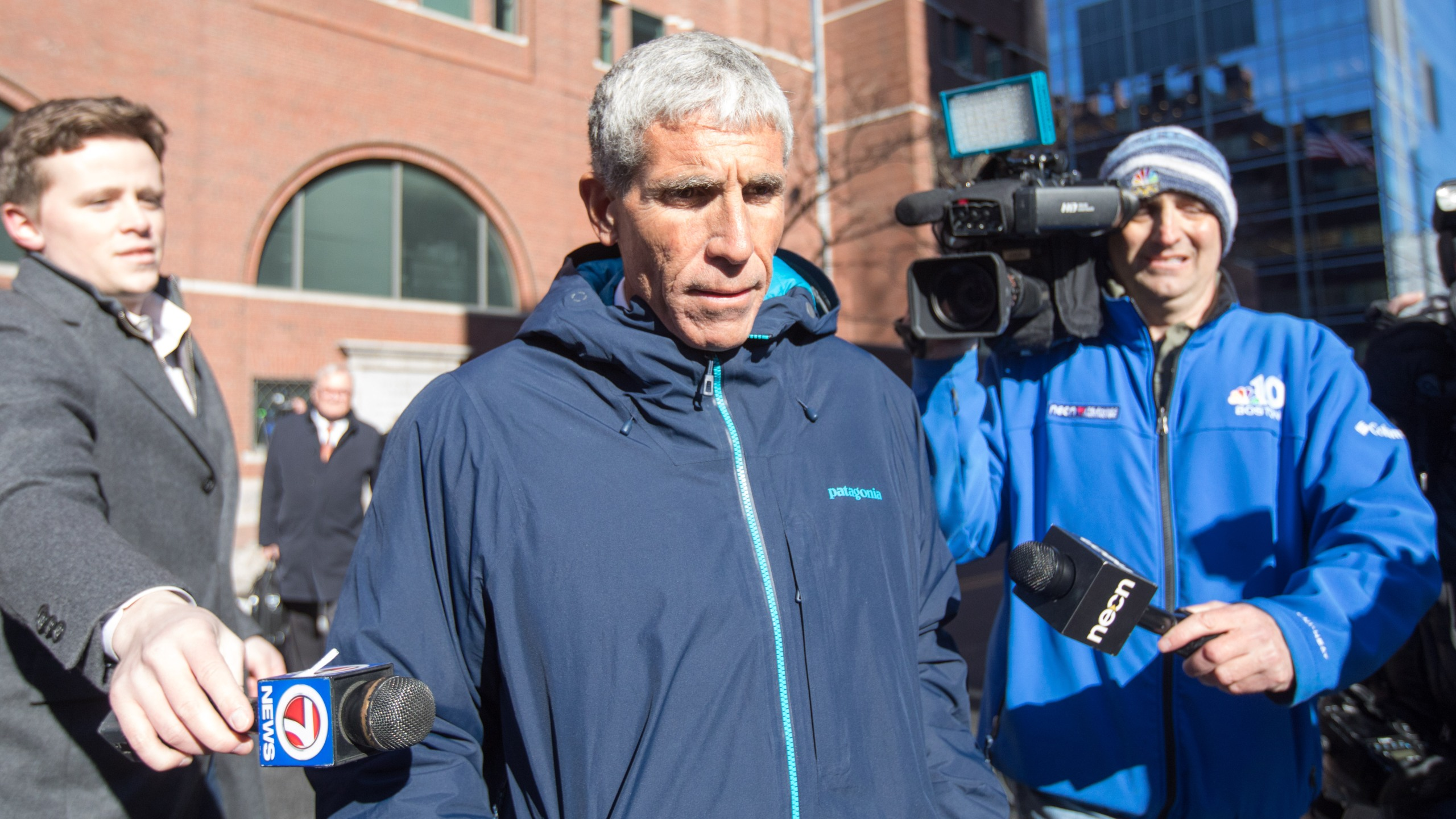 "William ""Rick"" Singer leaves Boston Federal Court after being charged with racketeering conspiracy, money laundering conspiracy, conspiracy to defraud the United States and obstruction of justice on March 12, 2019. (Credit: Scott Eisen / Getty Images)"