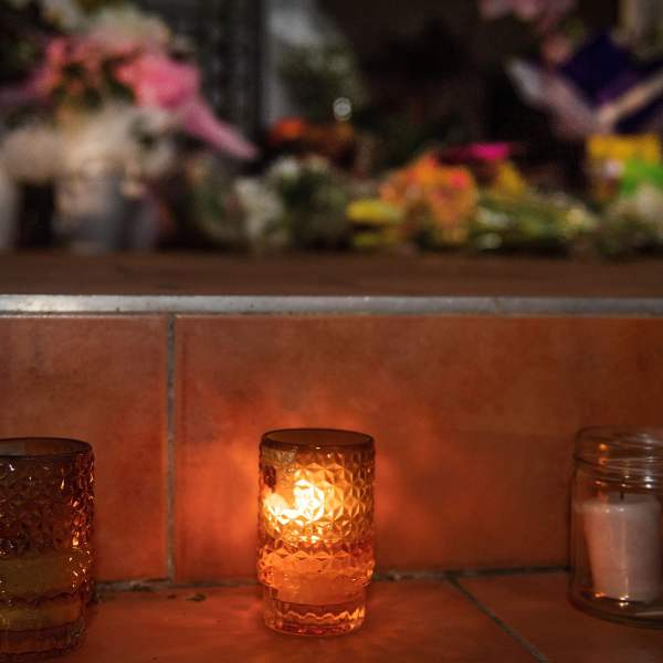 Flowers and candles are placed on the front steps of the Wellington Masjid mosque in Kilbirnie in Wellington on March 15, 2019, after a shooting incident at two mosques in Christchurch. (Credit: MARTY MELVILLE/AFP/Getty Images)