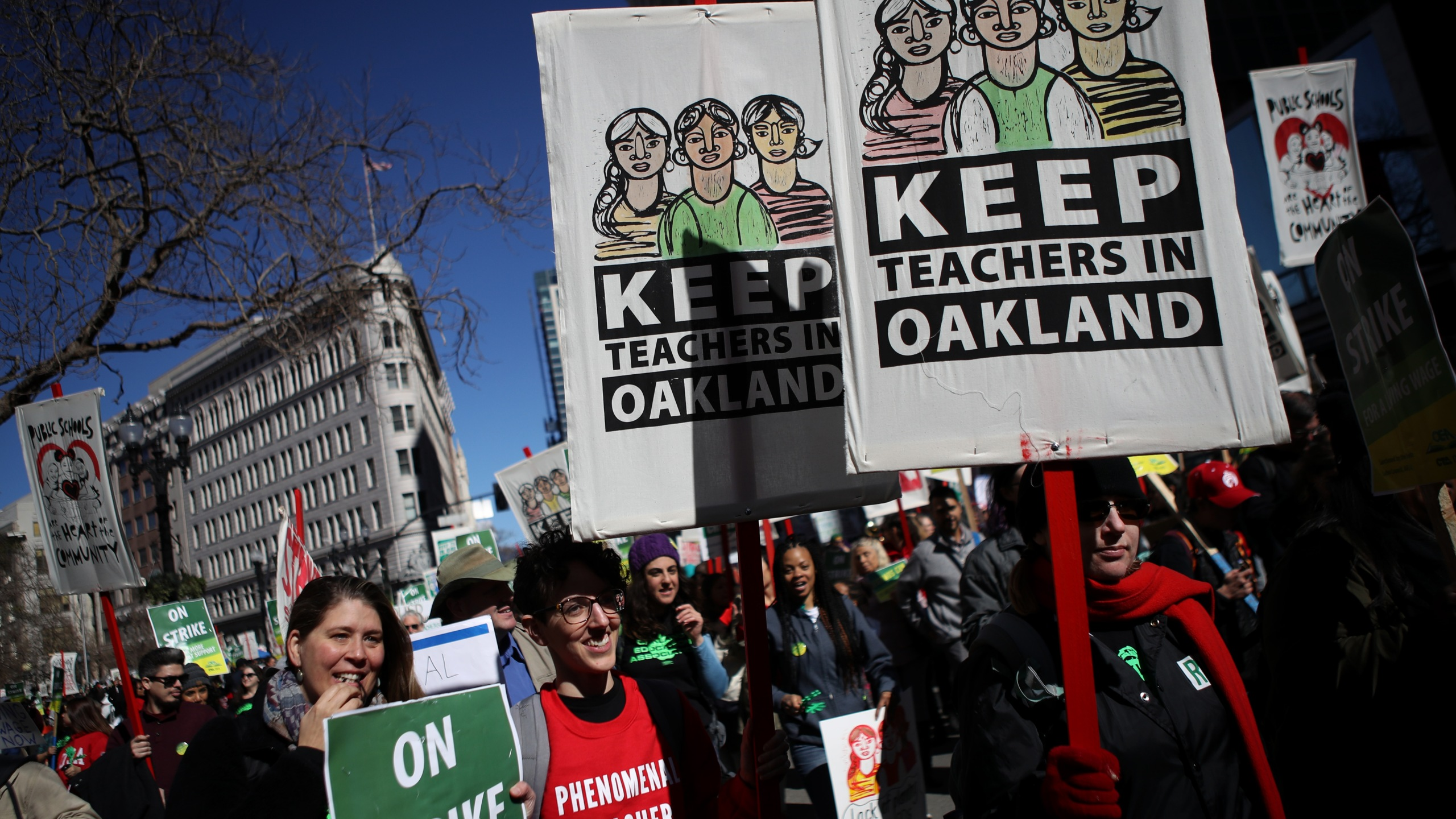 Oakland Unified School District students, teachers and parent carry signs as they march to the Oakland Unified School District headquarters on February 21, 2019 in Oakland, California. (Credit: Justin Sullivan/Getty Images)