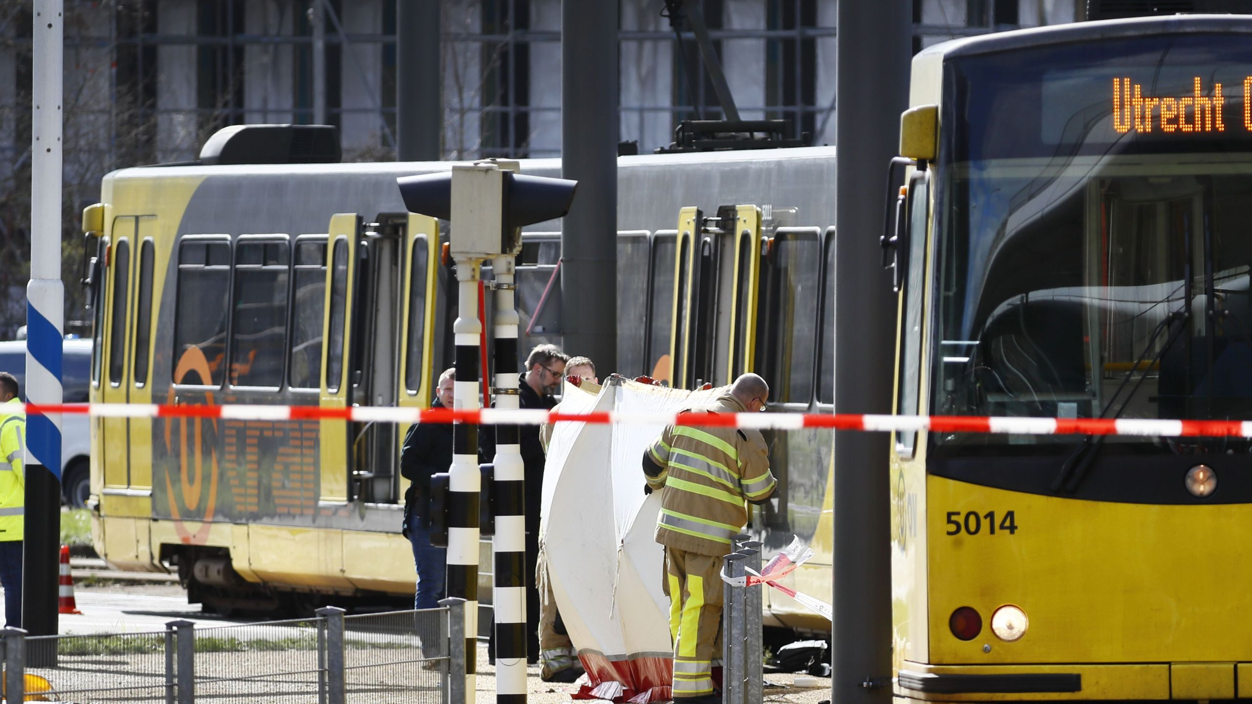 Police forces and emergency services stand at the 24 Oktoberplace in Utrecht, on March 18, 2019 where a shooting took place. (Credit: ROBIN VAN LONKHUIJSEN/AFP/Getty Images)