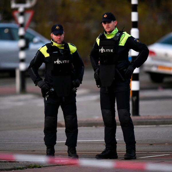 Policemen stand near a tram where a gunman opened fire killing at least three persons and wounding several in what officials said was a possible terrorist incident, on March 18, 2019 in Utrecht. (Credit: JOHN THYS/AFP/Getty Images)