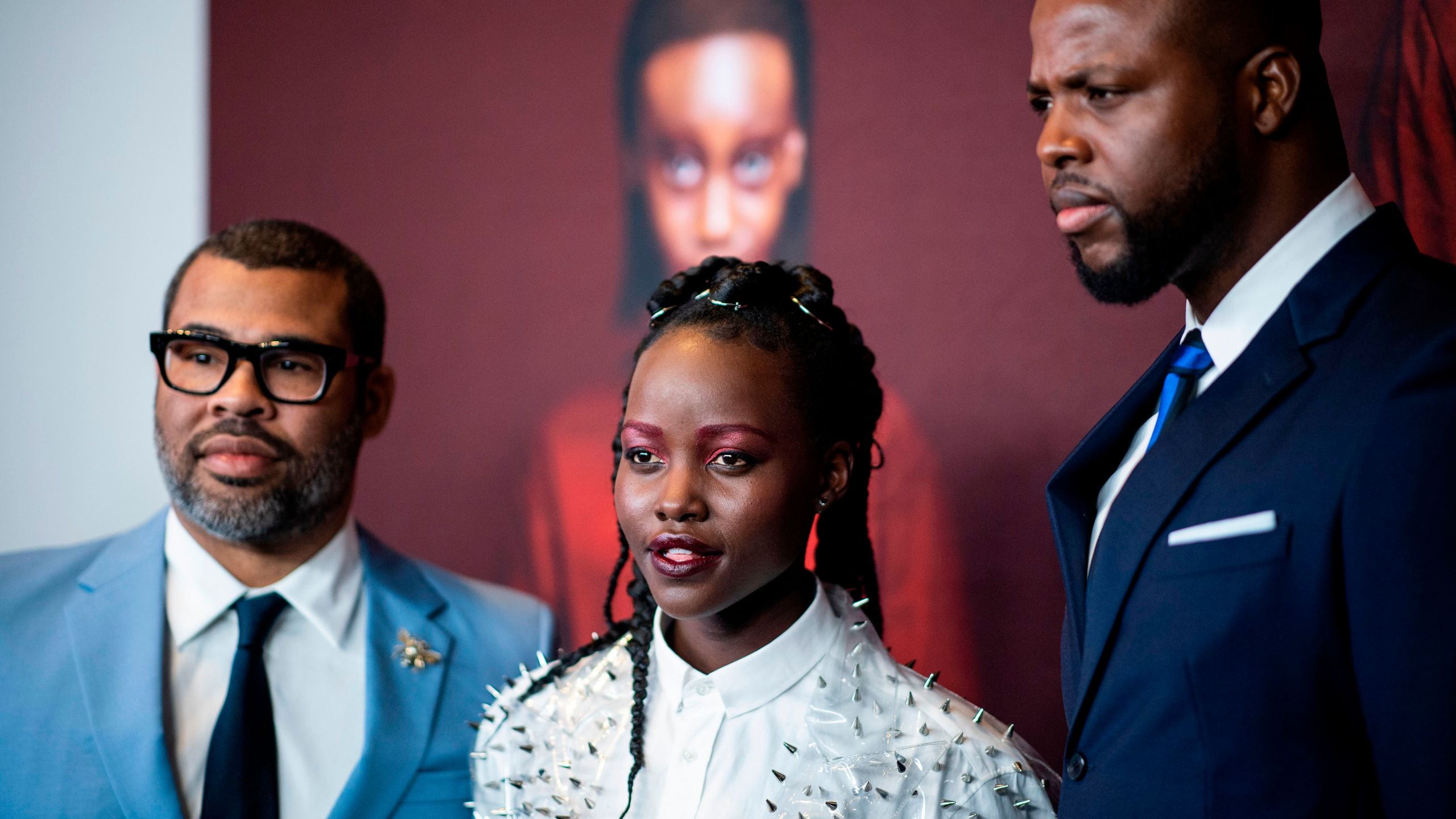 """Director/writer Jordan Peele, actress Lupita Nyong'o and actor Winston Duke arrive for the New York premiere of """"US"""" at the Museum of Modern Art in New York City. (Credit: JOHANNES EISELE/AFP/Getty Images)"""